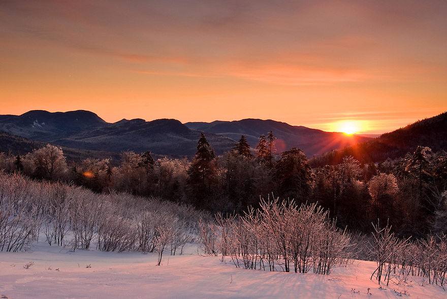 A red dawn breaks over the ice encrusted White Mountains of New Hampshire.