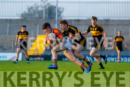 David Mangan, Mid Kerry in action against Gavin White (Captain), Dr. Crokes during the Kerry County Senior Football Championship Semi-Final match between Mid Kerry and Dr Crokes at Austin Stack Park in Tralee, Kerry.