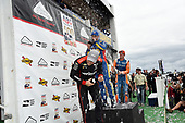 Will Power, Team Penske Chevrolet, Alexander Rossi, Andretti Autosport Honda and Scott Dixon, Chip Ganassi Racing Honda spray champagne