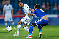 Paris Cowan-Hall of Wycombe Wanderers has his shirt pulled by Andreas Bjelland of Brentford during the Friendly match between Wycombe Wanderers and Brentford at Adams Park, High Wycombe, England on 19 July 2016. Photo by David Horn PRiME Media Images.