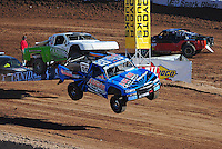Dec. 9, 2011; Chandler, AZ, USA;  LOORRS pro 4 unlimited driver Robby Woods leads Jeff Geiser during qualifying for round 15 at Firebird International Raceway. Mandatory Credit: Mark J. Rebilas-