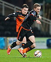 Killie's Ross Barbour is challenged by Dundee Utd's Paul Paton.