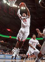 CHARLOTTESVILLE, VA- NOVEMBER 26:  Akil Mitchell #25 of the Virginia Cavaliers grabs a rebound during the game on November 26, 2011 at the John Paul Jones Arena in Charlottesville, Virginia. Virginia defeated Green Bay 68-42. (Photo by Andrew Shurtleff/Getty Images) *** Local Caption *** Akil Mitchell