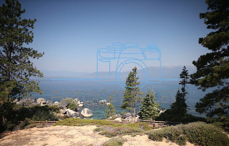 Skies remain smoky from wildland fires around the region as officials meet for the 22nd annual Lake Tahoe Summit, at Sand Harbor State Park, near Incline Village, Nev., on Tuesday, Aug. 7, 2018. <br /> Photo by Cathleen Allison/Nevada Momentum