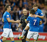 Lewis Macleod scores the opening goal for Rangers and celebrateswith Andy Little and Jon Daly