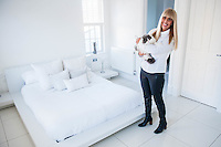 "COPY BY TOM BEDFORD<br /> Pictured: Claire Dix holding Darcy the cat in one of the bedrooms<br /> Re: A home-loving mum is looking forward to a bright 2017 - everything she owns is white.  <br /> Claire Dix, 51, lives in white house where all the inside walls, floors and ceilings are white.<br /> Her furniture is white, her sheets and towels are white - even her Persian cat Mr Darcy is white.<br /> She drives a white Porsche sports car and the other family car is - you've guessed, it white.<br /> And to keep her home spotless she even has a white, limited-edition Dyson cleaner.<br /> Claire said: ""It's not an obsession, just a matter of style - I happen to like white."