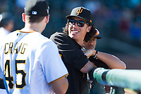Surprise Saguaros infielder Cole Tucker (2), of the Pittsburgh Pirates organization, in the dugout with Will Craig (45) during an Arizona Fall League game against the Peoria Javelinas at Surprise Stadium on October 17, 2018 in Surprise, Arizona. (Zachary Lucy/Four Seam Images)