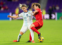 ORLANDO, FL - FEBRUARY 21: Clarisa Huber #8 of Argentina collides with Allysha Chapman #2 of Canada during a game between Canada and Argentina at Exploria Stadium on February 21, 2021 in Orlando, Florida.