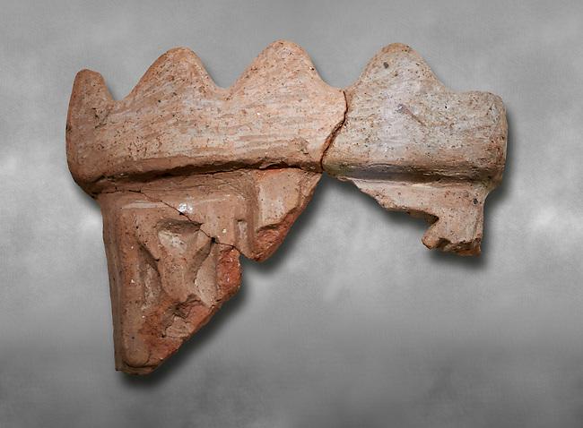 Hittite terra cotta fragmants of a defenive wall tower shaped vessel . Hittite Period, 1600 - 1200 BC.  Hattusa Boğazkale. Çorum Archaeological Museum, Corum, Turkey. Against a grey bacground.
