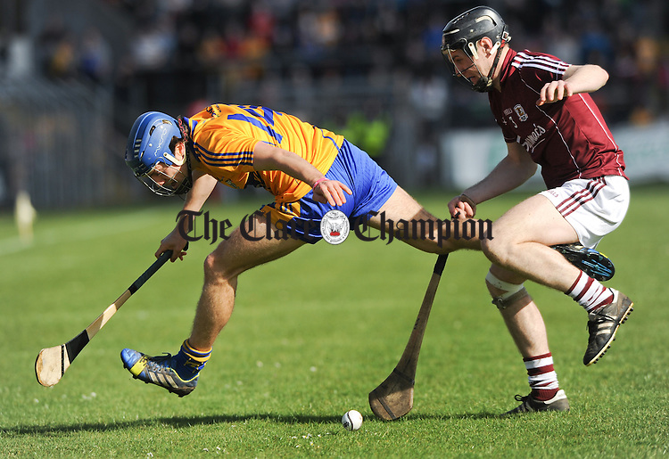 Shane O Donnell of Clare in action against Ronan Burke of Galway during their NHL Division 1 Round 5 game at Cusack park, Ennis. Photograph by John Kelly.