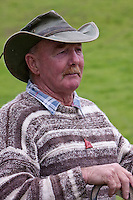 A New Zealand Sheep Herder (Musterer) near Masterton, Wairarapa region, north island, New Zealand.  A dog whistle is on a string around his neck.