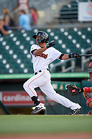 Jupiter Hammerheads left fielder Jhonny Santos (30) hits a single during a game against the Palm Beach Cardinals on August 4, 2018 at Roger Dean Chevrolet Stadium in Jupiter, Florida.  Palm Beach defeated Jupiter 7-6.  (Mike Janes/Four Seam Images)
