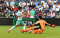 KANSAS CITY, KS - AUGUST 10: Victor Davila #7 of Club Leon FC tries to dribble around John Pulskamp #1 of Sporting Kansas City during a game between Club Leon FC and Sporting KC at Children's Mercy Park on August 10, 2021 in Kansas City, Kansas.
