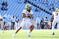 CHAPEL HILL, NC - NOVEMBER 14: Sam Hartman #10 of Wake Forest looks for an open receiver during a game between Wake Forest and North Carolina at Kenan Memorial Stadium on November 14, 2020 in Chapel Hill, North Carolina.