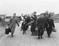 Hungarian refugees in transit to Canada arrive in the army town of Budel, HOLLAND  for a 6-day reception. January 14, 1957.<br /> <br /> Photographer Pot, Harry / Anefo