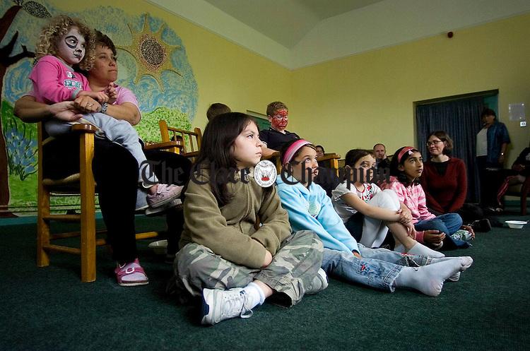 Eddie Lenihan keeps the kids attention for storytime during World Refugee Day Celebrations at St Michaels Hall Ennis.Pic Arthur Ellis.