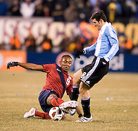 Juan Agudelo (9) of the United States tackles the ball away from Javier Zanetti (8) of Argentina during an international friendly at New Meadowlands Stadium in East Rutherford, NJ.  The United States tied Argentina, 1-1.