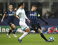 Football: UEFA Champions League -Group Stage - Group B - FC Internazionale Milano vs PSV Eindhoven, Giuseppe Meazza  (San Siro) Stadium, Milan Italy, December 11, 2018.<br /> Inter Milan's Captain Mauro Icardi (r) in action with PSV Eindhoven's Trent Sainsbury (l) during the Uefa Champions League football match between Inter Milan and PSV Eindhoven at Giuseppe Meazza  (San Siro) Stadium in Milan on December 11, 2018. <br /> UPDATE IMAGES PRESS/Isabella Bonotto