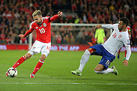 (L-R) Aaron Ramsey of Wales is tackled by Luka Milivojevic of Serbia during the 2018 FIFA World Cup Qualifier between Wales and Serbia at the Cardiff City Stadium, Wales, UK. Saturday 12 November 2016