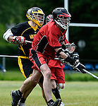 GER - Hannover, Germany, May 30: During the Men Lacrosse Playoffs 2015 match between HTHC Hamburg (black) and DHC Hannover (red) on May 30, 2015 at Deutscher Hockey-Club Hannover e.V. in Hannover, Germany. Final score 17:2. (Photo by Dirk Markgraf / www.265-images.com) *** Local caption *** Philipp Demmer #4 of DHC Hannover