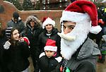 TORRINGTON CT. 23 December 2017-122217SV02-Brandon Valentin, 18, of Naugatuck wait to get in the Christmas Village with his family in Torrington Saturday.<br /> Steven Valenti Republican-American