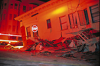 A collapsed building in the San Francisco Marina district as a result of the Loma Prieta Earthquake, 1989 at night