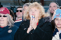 Deborah Helman, of Martinsburg, West Virginia, watches as Texas senator and Republican presidential candidate Ted Cruz speaks at a Second Amendment Rally outside Granite State Indoor Range in Hudson, New Hampshire.