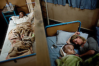 Cecilie sleeps next to Victoria at Annapurna Neurological Institute in Kathmandu while another patient sleeps next door. 19 month old Victoria (formerly named Ghane) was born with hydrocephalus and was left abandoned. Cecilie Hansen was so moved by the story of Ghane she read in a Danish newspaper that she decided to fly to Kathmandu to try to assist her and show her the love of another human being; Cecilie eventually became her legal guardian. Victoria died on November 19 2010 from heart failure.