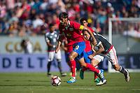Orlando, Florida - Saturday, June 04, 2016: Costa Rican midfielder Bryan Ruiz (10) dribbles away from Paraguayan forward Robert Piris Da Motta (23) during a Group A Copa America Centenario match between Costa Rica and Paraguay at Camping World Stadium.
