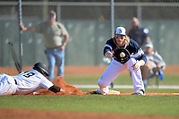 UW-Stout Blue Devils Jake Johnson (18) waits for a throw as Nick Lehner (18) dives back to first during the first game of a doubleheader against the Edgewood Eagles on March 16, 2015 at Lee County Player Development Complex in Fort Myers, Florida.  UW-Stout defeated Edgewood 6-1.  (Mike Janes/Four Seam Images)