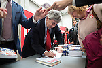 © Joel Goodman - 07973 332324 . 16/06/2016 . Manchester , UK .  People buy signed copies of Gordon Brown's book after the speeches . Labour Shadow Chancellor , John McDonnell MP and former Labour Prime Minister , Gordon Brown , speak at a Labour IN campaign event at the Union at the University of Manchester . Photo credit : Joel Goodman