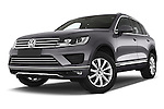 Stock pictures of low aggressive front three quarter view of a 2015 Volkswagen Touareg Bluemotion 5 Door SUV Low Aggressive