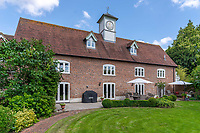 BNPS.co.uk (01202 558833)<br /> Pic: Mullucks/BNPS<br /> <br /> Pictured: The Clockhouse complete with the 10ft central wooden clock tower. <br /> <br /> Time for a change...<br /> <br /> A former granary with an impressive clock tower on top is on the market for £1.45m.<br /> <br /> The new owners of the aptly-named The Clockhouse will have a tall order adjusting this timepiece when the clocks go back at the end of October.<br /> <br /> The Grade II listed property has a 10ft central wooden clock tower which is believed to date back to the construction of the original granary building in the Georgian era.