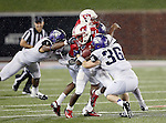 Southern Methodist Mustangs wide receiver Jeremy Johnson (15), TCU Horned Frogs linebacker Joel Hasley (36) and TCU Horned Frogs safety Chris Hackett (1) in action during the game between the Southern Methodist Mustangs and the TCU Horned Frogs at the Gerald J. Ford Stadium in Dallas, Texas. TCU defeats SMU 24 to 16.