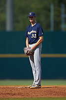 Pitcher Hagen Banks (32) of Calhoun HS in Plainville, GA playing for the Milwaukee Brewers scout team in action during the East Coast Pro Showcase at the Hoover Met Complex on August 5, 2020 in Hoover, AL. (Brian Westerholt/Four Seam Images)