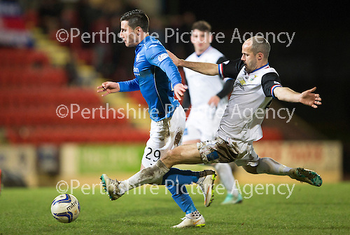 St Johnstone v Inverness Caledonian Thistle...20.12.14   SPFL<br /> Michael O'Halloran is fouled by David Raven<br /> Picture by Graeme Hart.<br /> Copyright Perthshire Picture Agency<br /> Tel: 01738 623350  Mobile: 07990 594431