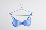 Blue bra on hanger, studio shot