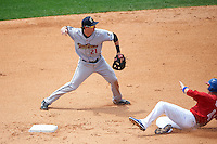 Scranton/Wilkes-Barre RailRiders shortstop Nick Noonan (21) turns a double play as Andy Burns (41) slides in during a game against the Buffalo Bisons on June 10, 2015 at Coca-Cola Field in Buffalo, New York.  Scranton/Wilkes-Barre defeated Buffalo 7-2.  (Mike Janes/Four Seam Images)