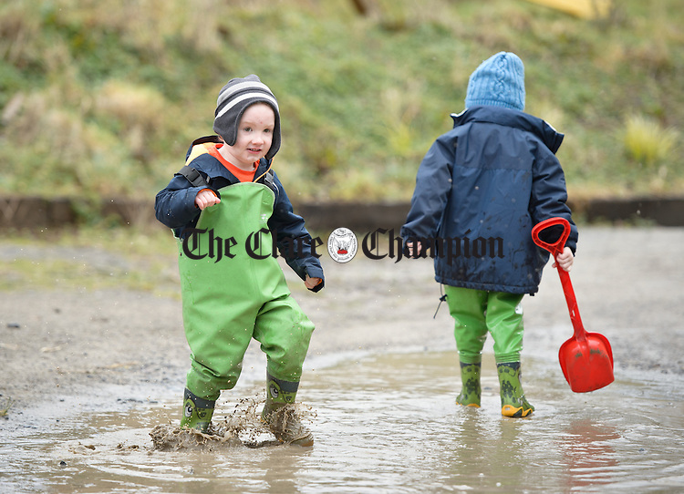 Rory Meade has fun in a puddle outside during a Pyjama Day party at Teach Spraoi, Toonagh as part of the annual Pyjama Day for Autism. Photograph by John Kelly.