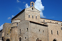 Anagni: A view of piazza Innocenzo III, with the Palazzo Comunale and the back of the Duomo, under a blue sky with some clouds.