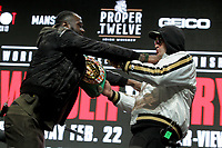 Deontay Wilder, USA, and Tyson Fury, UK,--US boxer Deontay Wilder (L) and British boxer Tyson Fury get into an altercation during their press conference February 19, 2020 at the MGM Grand Las Vegas in Las Vegas, Nevada.  The boxers will fight for the World Boxing Council (WBC) Heavyweight Championship Title on February 22, 2020 at the MGM Grand Garden Arena in Las Vegas. (Photo by John Gurzinski)