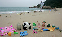 Plastic toys are seen washed up on the East-facing beach on the windward side of South Sokos Island, Hong Kong, China, 27 January 2010. South Sokos Island is one of a very small number of uninhabited islands in Hong Kong Special Administrative Region of China, and because it has no ferry service at all it is rarely visited by anyone. Consequently large amounts of marine-borne plastics build-up over time, with infrequent Hong Kong Government pollution clean-up efforts to tackle the problem. Common items found washed up on the beach at South Sokos Island include; lightbulbs, medical waste, plastic bottles, plastic cigarette lighters, plastic toys, plastic fishing equipment and plastic footwear. Another plastic item frequently found in large quantities on Soko Island, but also on polluted beaches the world over, is the pre-production plastic pellet, or 'nurdle', that is used in the manufacturing of plastic products. ALEX HOFFORD