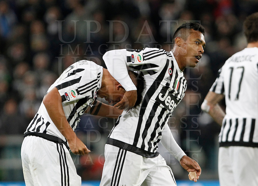 Calcio, Serie A: Juventus vs Milan. Torino, Juventus Stadium, 21 novembre 2015. <br /> Juventus' Paulo Dybala, left, is congratulated by his teammate Alex Sandro after scoring the winning goal during the Italian Serie A football match between Juventus and AC Milan at Turin's Juventus stadium, 21 November 2015. Juventus won 1-0.<br /> UPDATE IMAGES PRESS/Isabella Bonotto