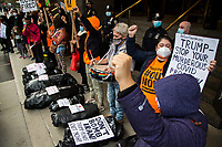 NEW YORK, UNITED STATES - NOVEMBER 21: Activists protest with black bags like corpses next to Trump International Hotel & Tower on November 21, 2020 in New York City. Some people gather in Columbus Circle to protest against the government of President Donald Trump, with a symbolic act where they use black bags as if they were corpses due to the thousands of deaths produced by Covid-19. Photo by Pablo Monsalve / VIEWpress via Getty Images)