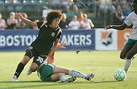 Eriko Arakawa (30) follows the ball after Stephanie Logterman's slide tackle. FC Gold Pride tied the St. Louis Athletica 1-1 at Buck Shaw Stadium in Santa Clara, California on August 9, 2009.