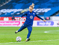 SOLNA, SWEDEN - APRIL 10: Emily Sonnett #14 of the USWNT warms up before a game between Sweden and USWNT at Friends Arena on April 10, 2021 in Solna, Sweden.