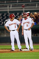 Harrisburg Senators pinch runner Stephen Perez (2) and coach Devin Ivany (11) during a game against the New Hampshire Fisher Cats on June 2, 2016 at FNB Field in Harrisburg, Pennsylvania.  New Hampshire defeated Harrisburg 2-1.  (Mike Janes/Four Seam Images)