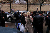 Moscow Russia.October 27, 2002..Family members cover their relatives who were former hostages held by Chechen banidts for three days in a theater in Moscow. As they are released they make their way from the hospital to their cars outside Hospital 13. ..After a siege of two and a half days, Russian OSNAZ raided the building after pumping a mysterious chemical agent into the building's ventilation system. All of the terrorists were killed by Russian forces, along with at least 129 of the hostages. There were conceivably more than 200 civilian deaths.