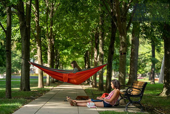 September 19, 2019; Students Hannah Morris '20 and Malia Marshall '21 (hammock) take advantage of the nice weather as they study on the Main Quad.  (Photo by Barbara Johnston/University of Notre Dame).