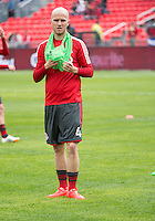 Toronto, Ontario - May 3, 2014: Toronto FC midfielder Michael Bradley #4 during the warm-up in a game between the New England Revolution and Toronto FC at BMO Field.<br /> The New England Revolution won 2-1.